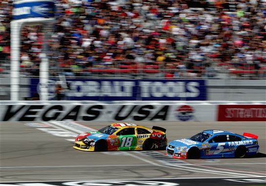 Kyle Busch and Kasey Kahne battle each other for position Sunday at Las Vegas. Photo- Getty Images